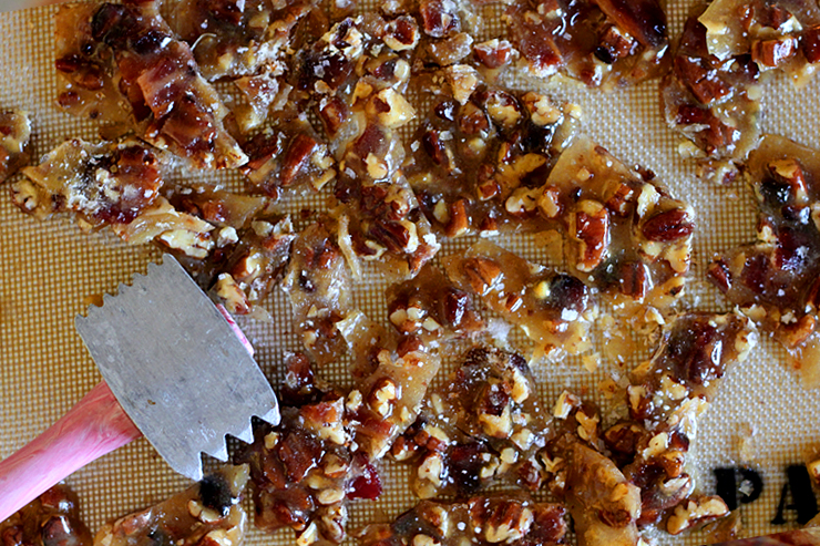 the last step of the bourbon bacon brittle recipe, breaking it up