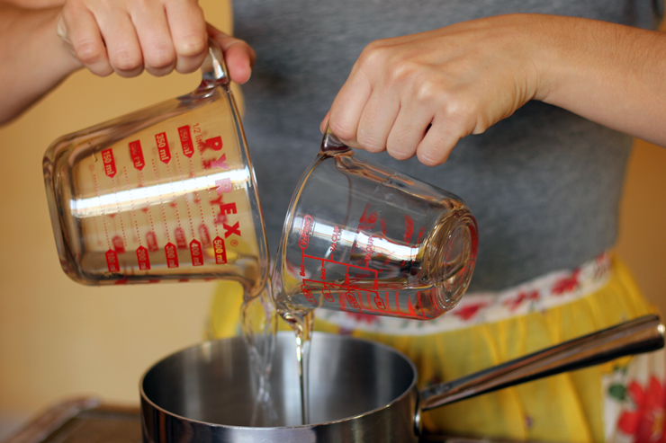 Combining sugar, water and corn syrup for the bourbon bacon brittle recipe