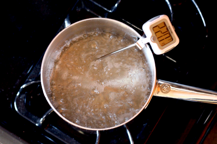 Heating the syrup for bourbon bacon brittle to 290 degrees