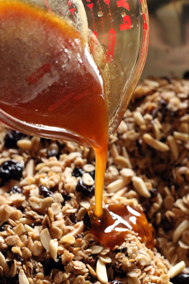 Once the syrup melts, pour it over the oat mixture.