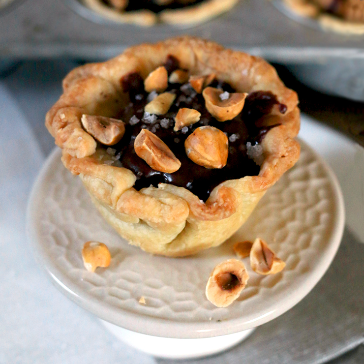 Espresso Chocolate Pudding Mini Pies topped with Hazelnuts and Vanilla Bean Flake Salt.