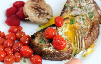 Eggs on a raft with sautéed cherry tomatoes