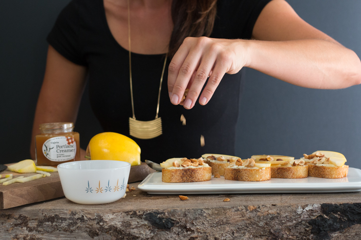 Becky Sue makes it rain hazelnuts on the goat cheese and crostini