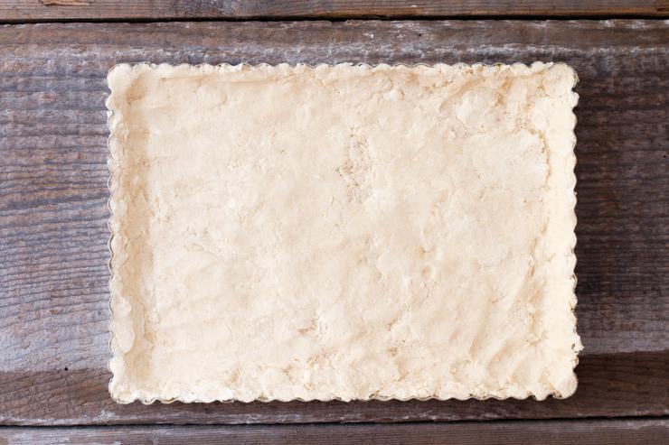 shortbread dough pressed into pan