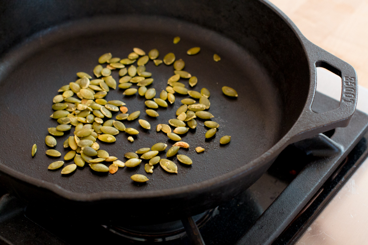 toasting pepitas in a cast iron skillet