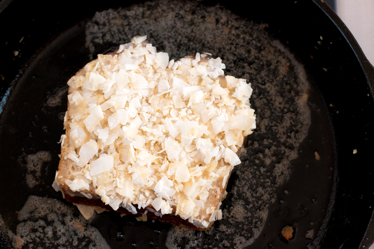 Coconut French Toast frying in cast iron skillet