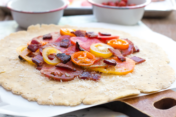 Added tomatoes to the bacon and pecorino cheese on the BLT Galette dough