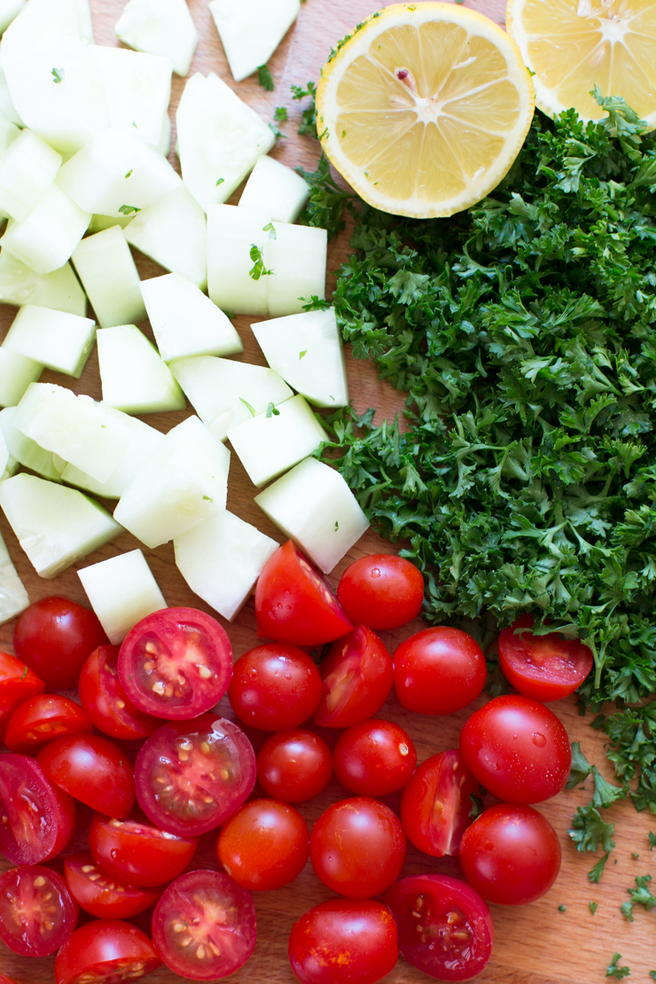 cherry tomatoes, sliced cucumber, freshly chopped parsley and lemon