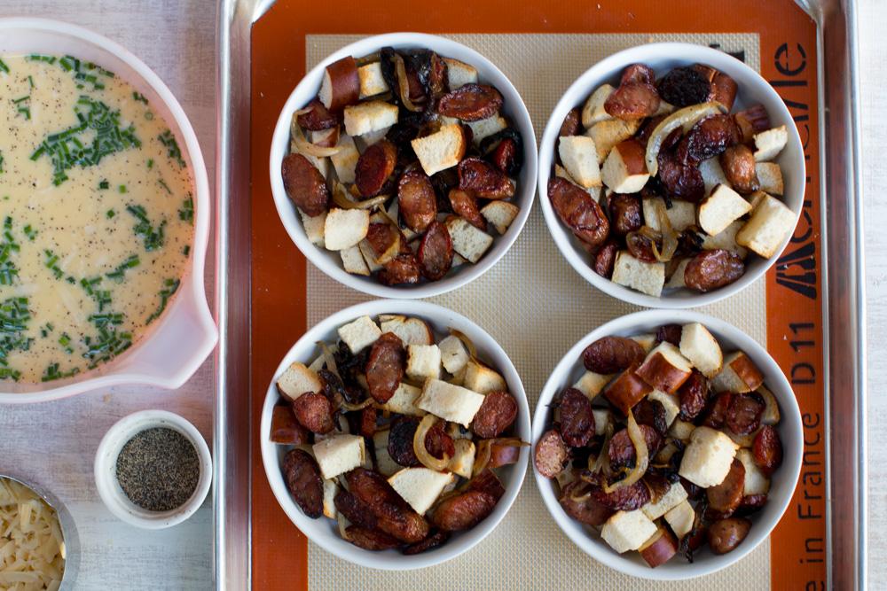 Sausage Gouda and Pretzel Strata split in 3 ramekins