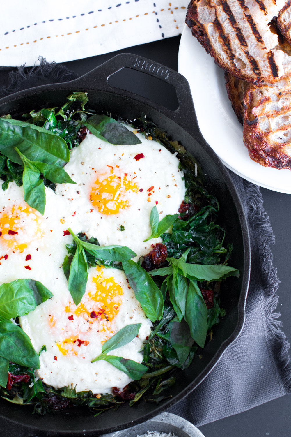 Baked Eggs with Ricotta, Greens & Sun Dried Tomatoes-31