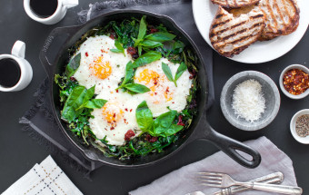 Baked Eggs with Ricotta, Greens & Sun Dried Tomatoes.