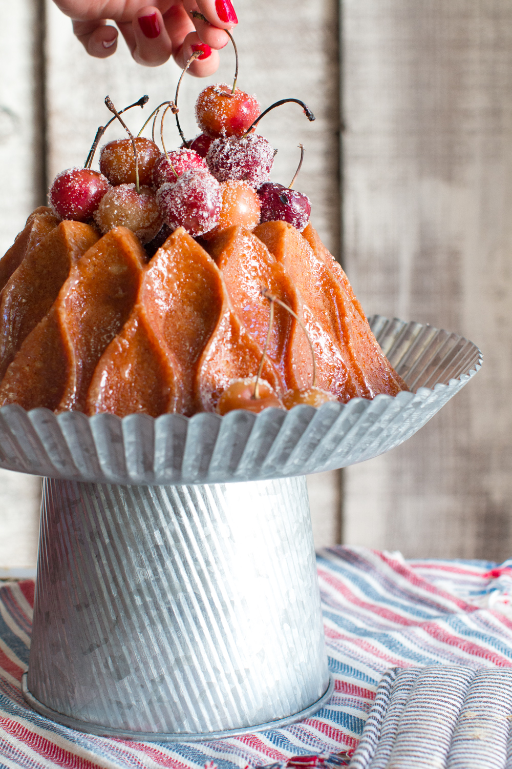Top the brown butter bourbon bundt cake with grilled cherries