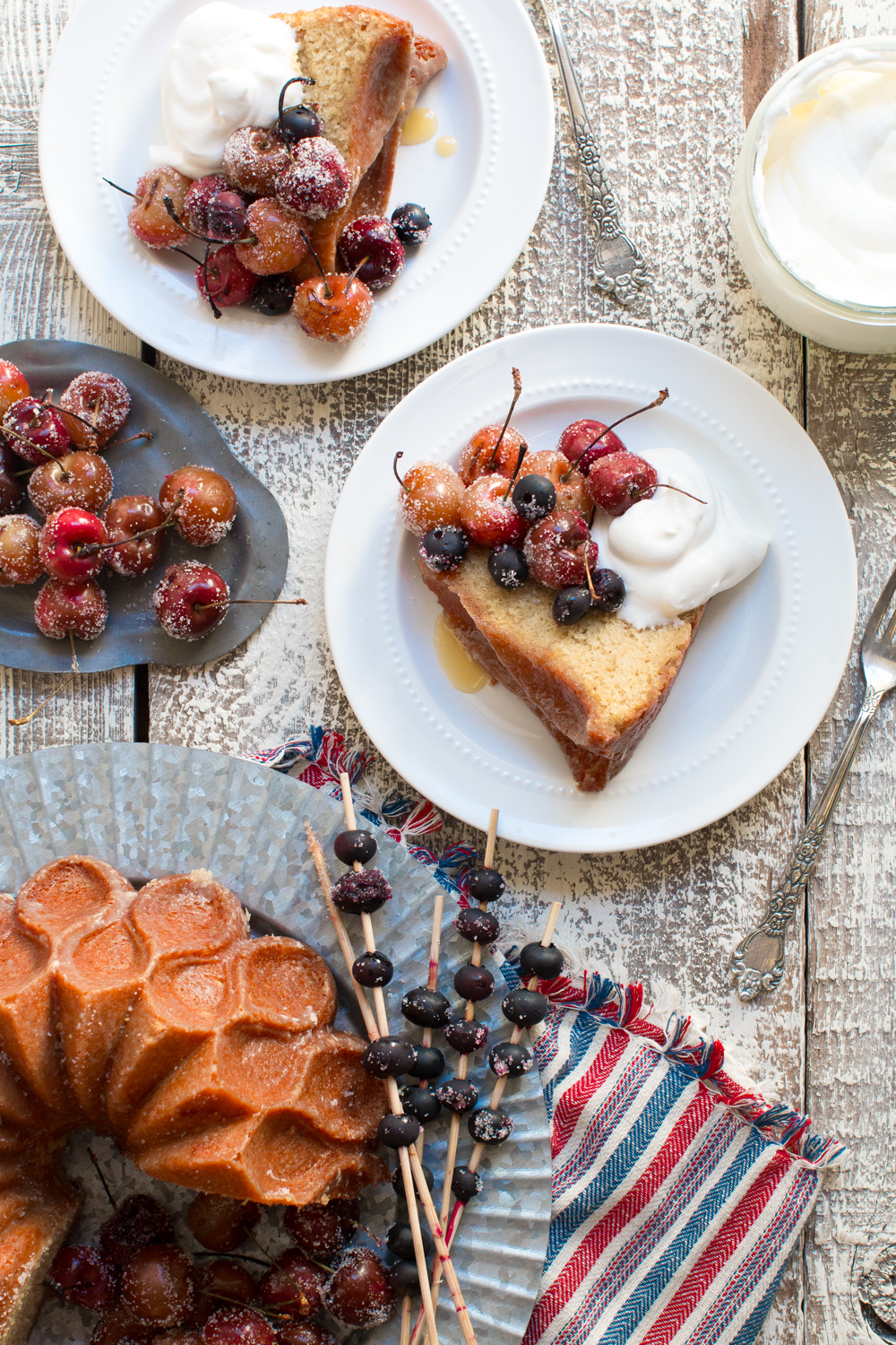 Brown Butter Bourbon Bundt Cake with Grilled Cherries, Blueberries and Whipped Cream