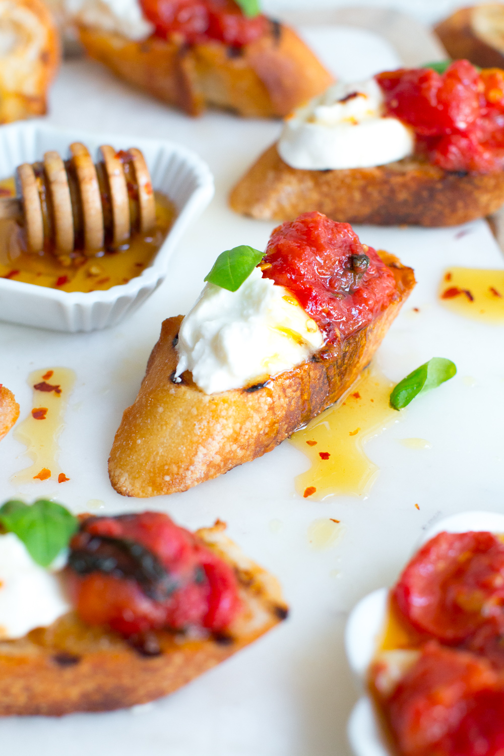 Tomato Confit & Burrata Crostini is the ultimate way to preserve those bright and sunny summer tomatoes