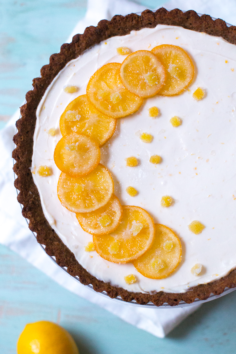 Top the Meyer Lemon Ginger Molasses Tart with the candied meyer lemon and ginger
