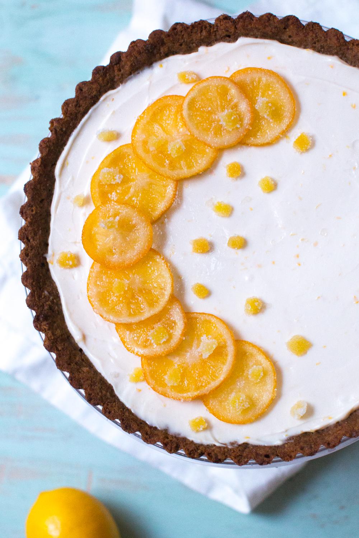 Top the Meyer Lemon Ginger Molasses Tart with the candied meyer lemon and ginger