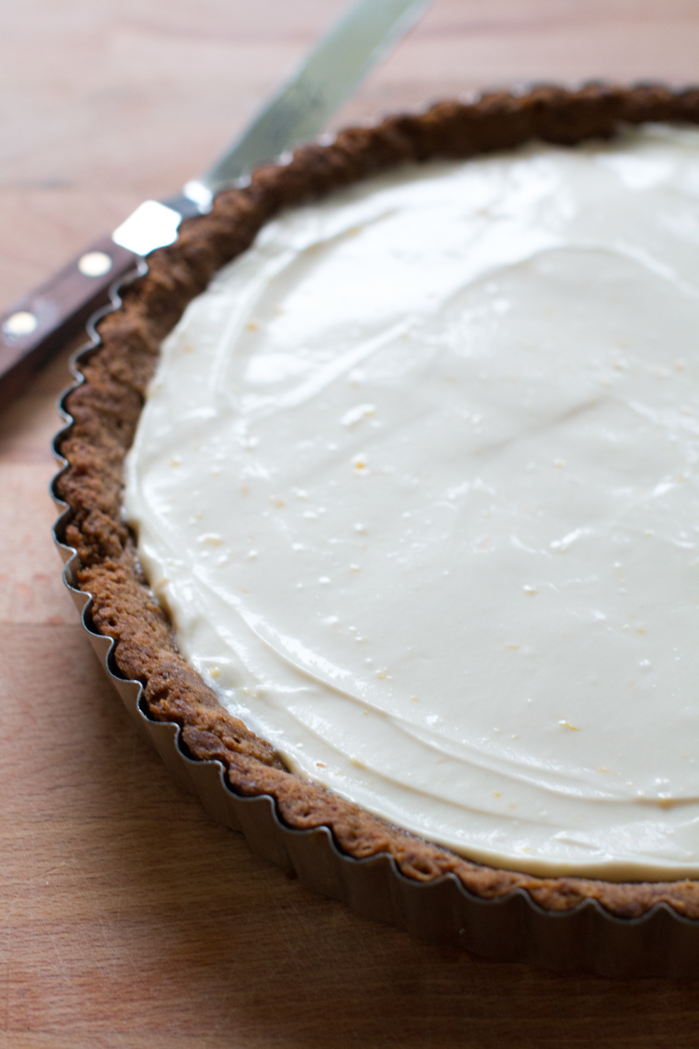 Fill the baked and chilled ginger molasses shell with the creamy meyer lemon and ginger mascarpone filling