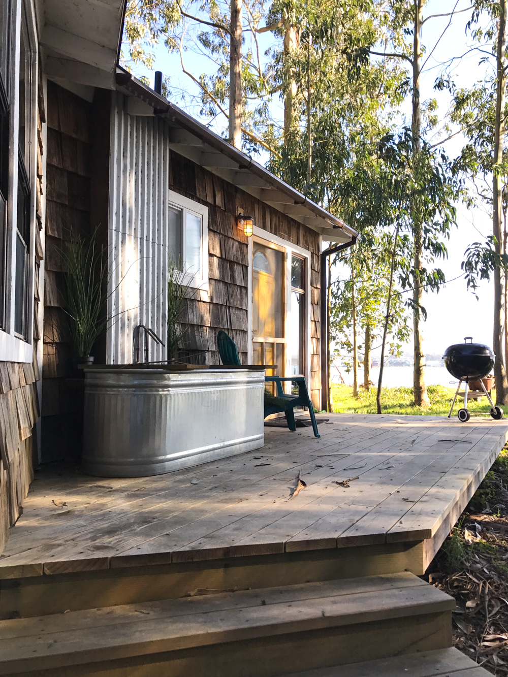 The porch and tub at the Mid Century Cabin at Oyster Beach Social Club in Eureka, CA.