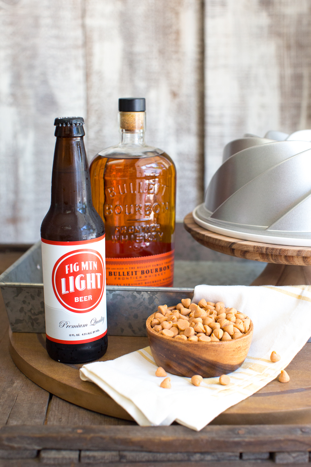 This One Bourbon, One Scotch, One Beer Bundt Cake has it all. Straight bourbon in both the cake and glaze, butterscotch chips and a a butterscotch glaze and a single ice cold beer in the center of the bundt!