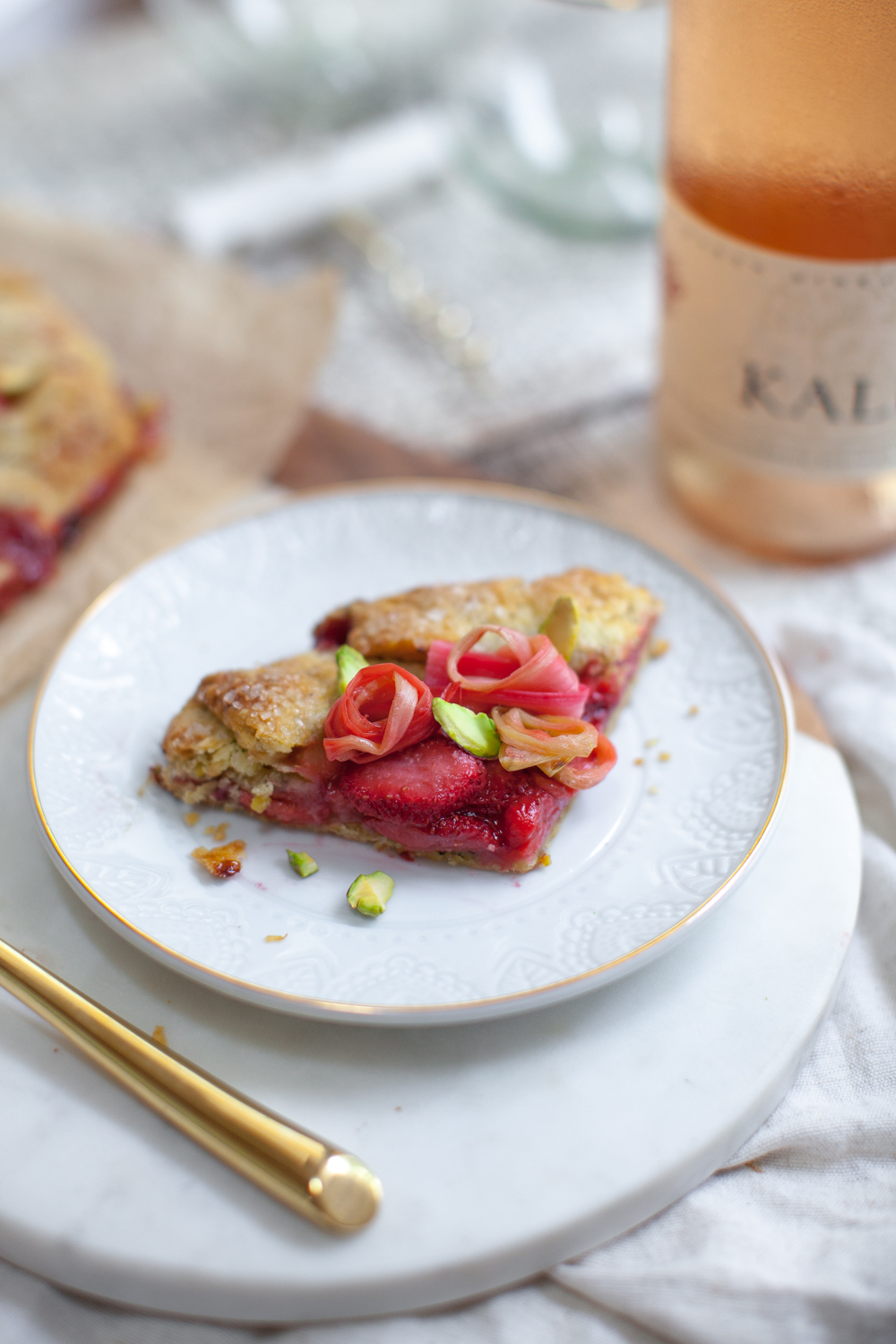 A little sliver of the Rhubarb Rose Strawberry Pistachio Galettes and some Kale Wines Rosé, almost too pretty to imbibe.