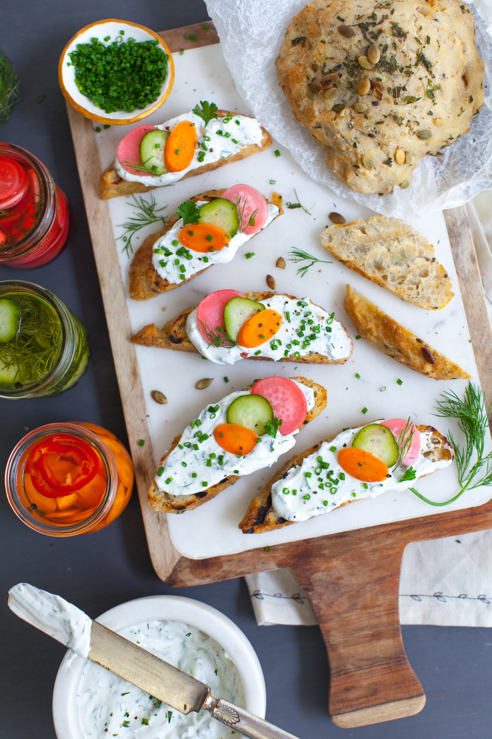 A party platter of Toast with Herbed Skyr and Quick Pickles