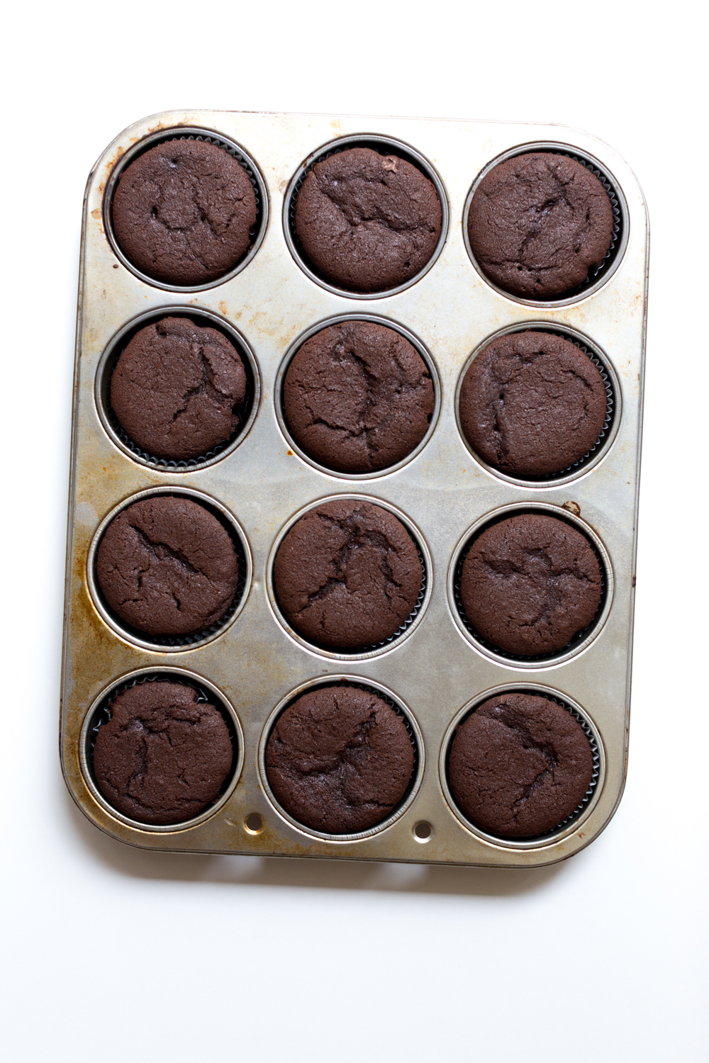 The cupcakes should bake up just above the top of the muffin tin.