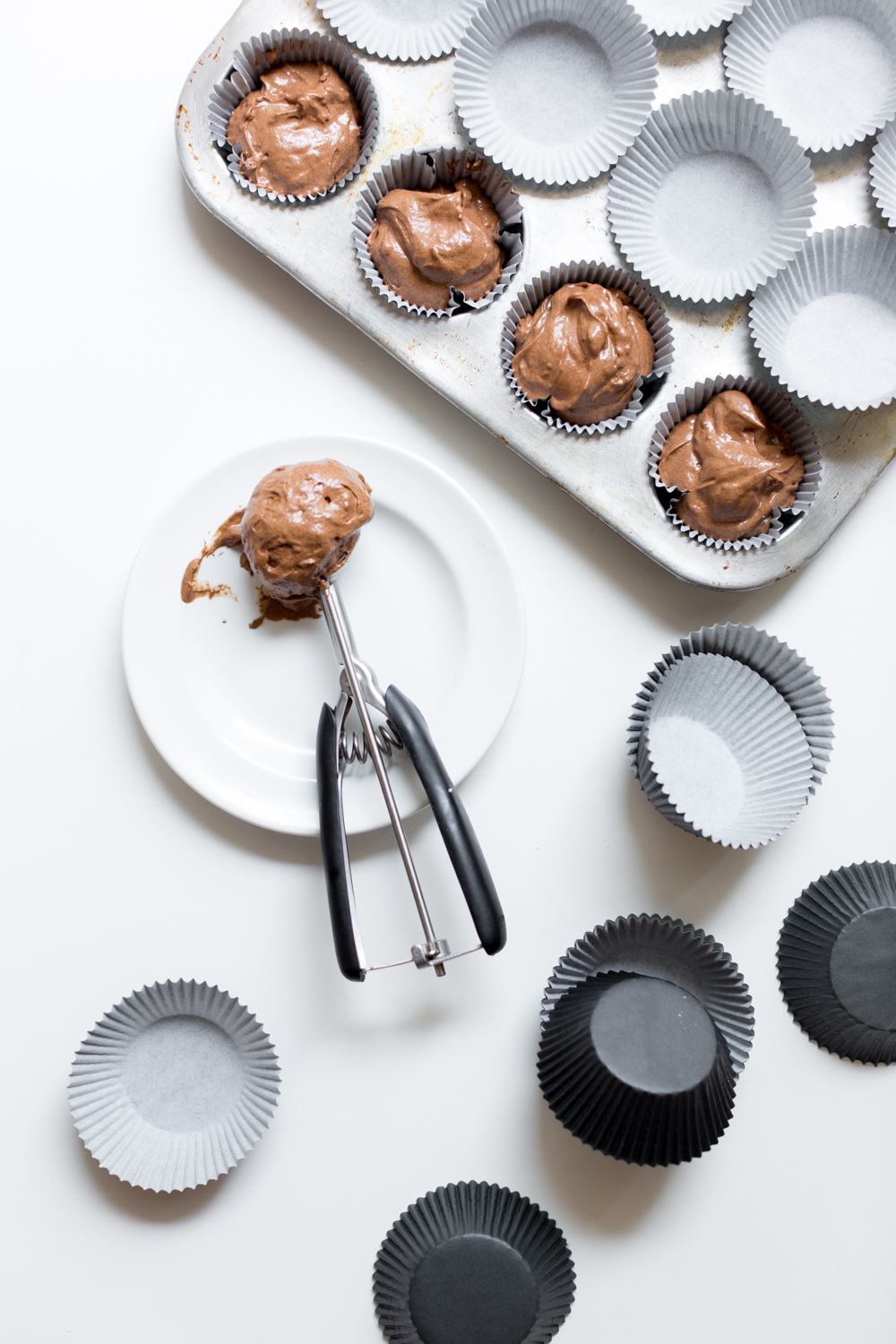 Scoop the batter into muffin tins lined with cupcake liners