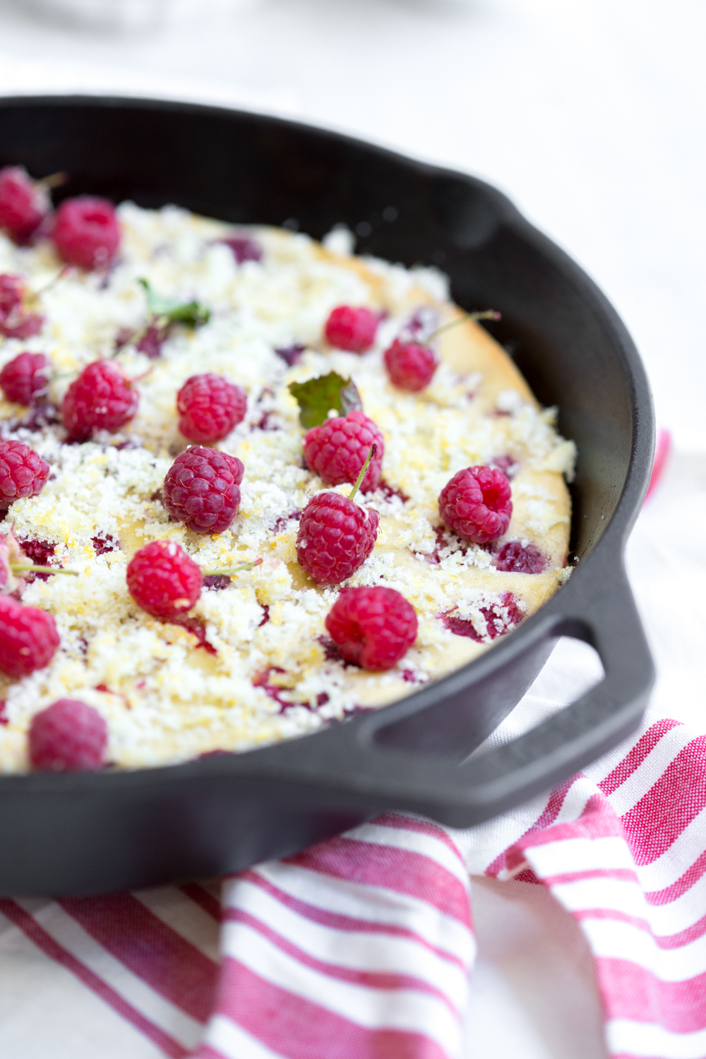 Raspberry Buttermilk Clafoutis with fresh berries.