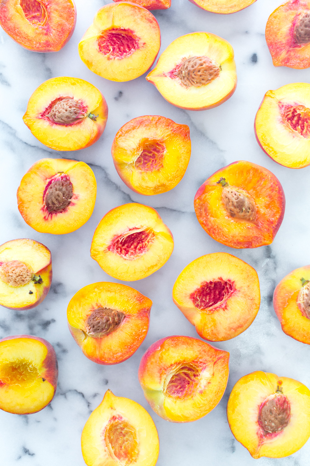 Halved and pitted peaches