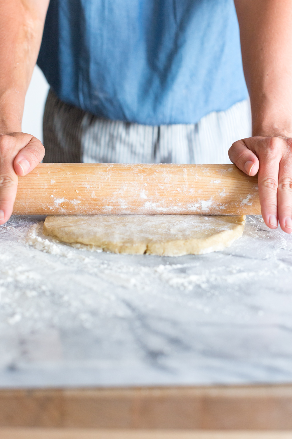 A baker rolling out rye pie dough