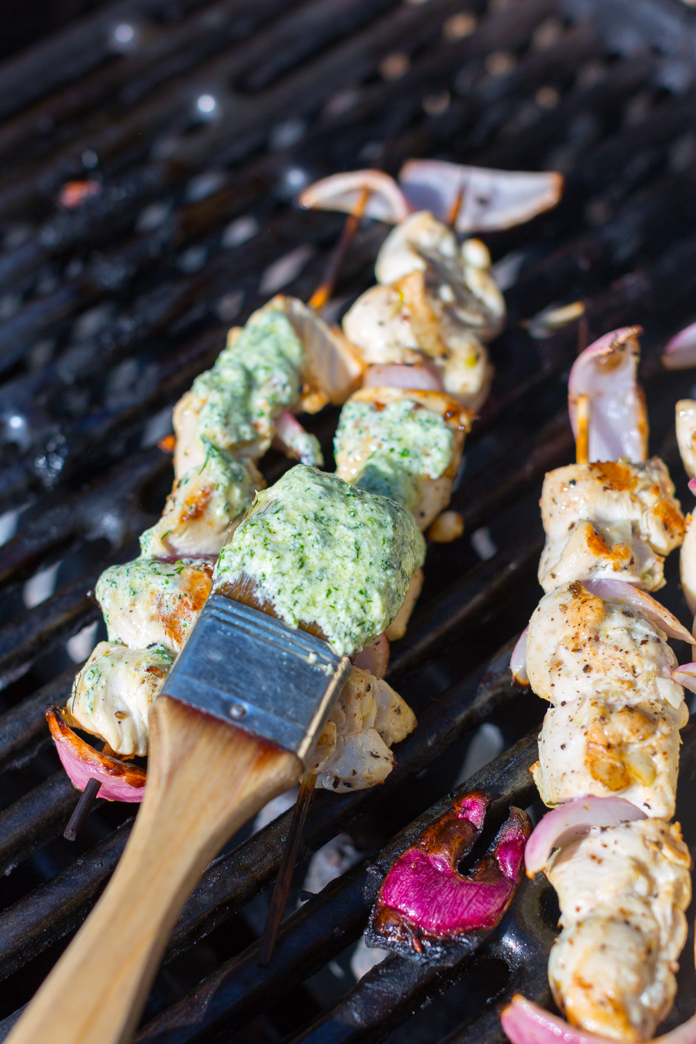 Baste the grilled chicken skewers with Herby Feta Sauce.