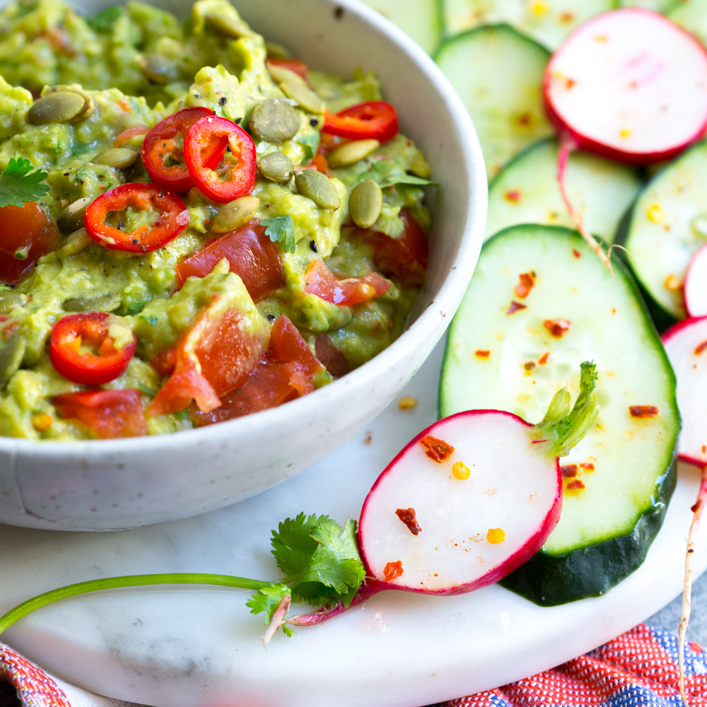 Guacamole with Spicy Cucumbers and Radishes.