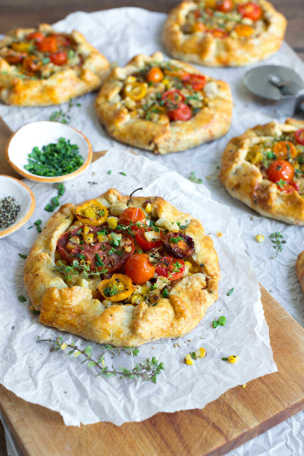 Summer in every bite of these Heirloom Tomato & Grilled Corn Galettes with Cheddar Crust.