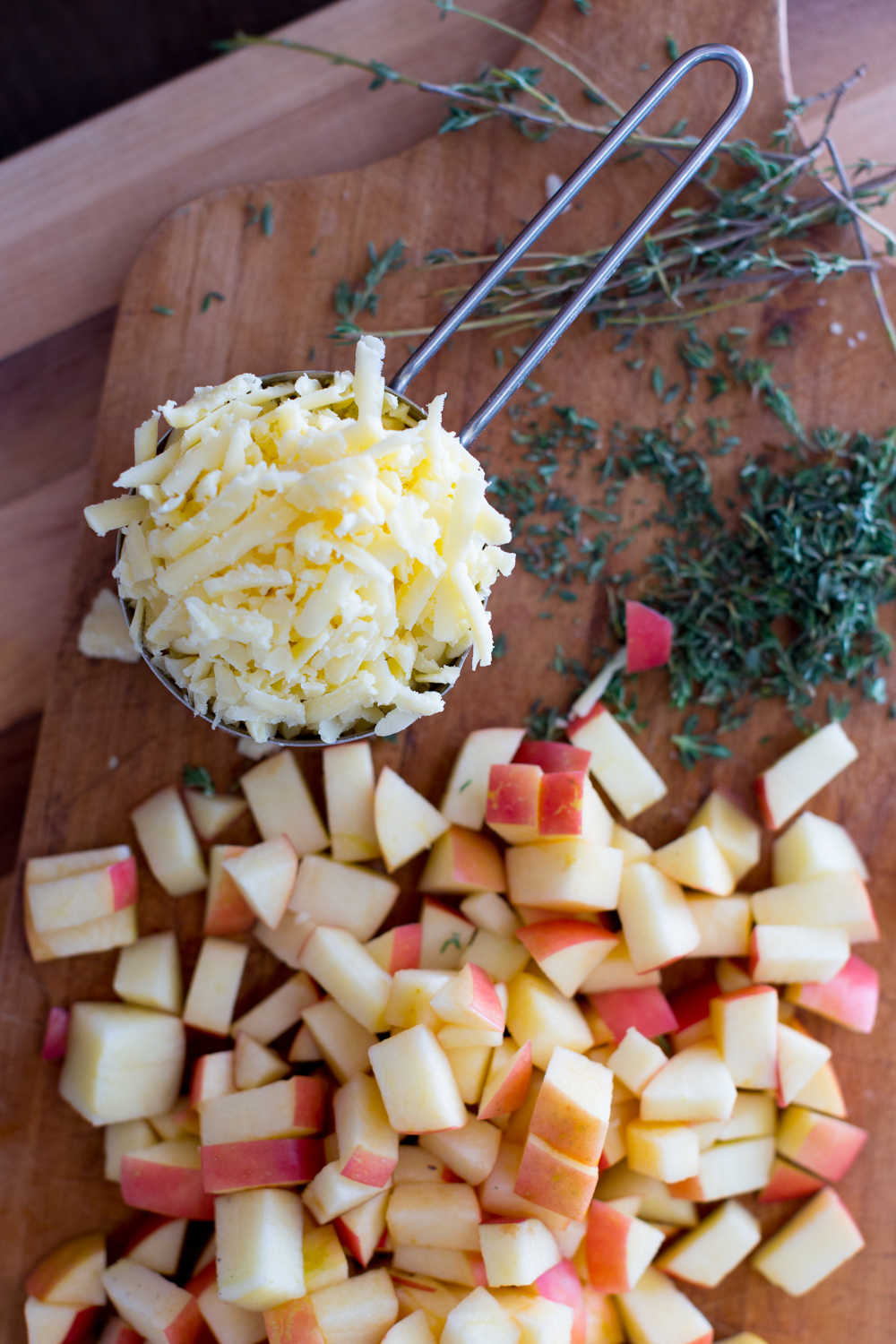 Bite sized apple bits, chunky shards of salty sweet cheddar and fresh herby thyme mix together for a comforting flavor profile.