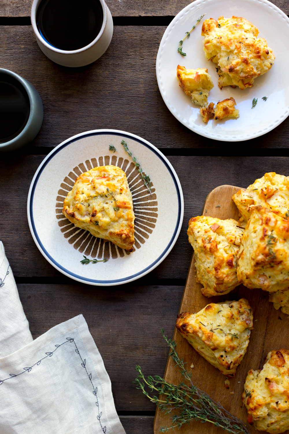 Apple Cheddar and Thyme Scones with coffee.
