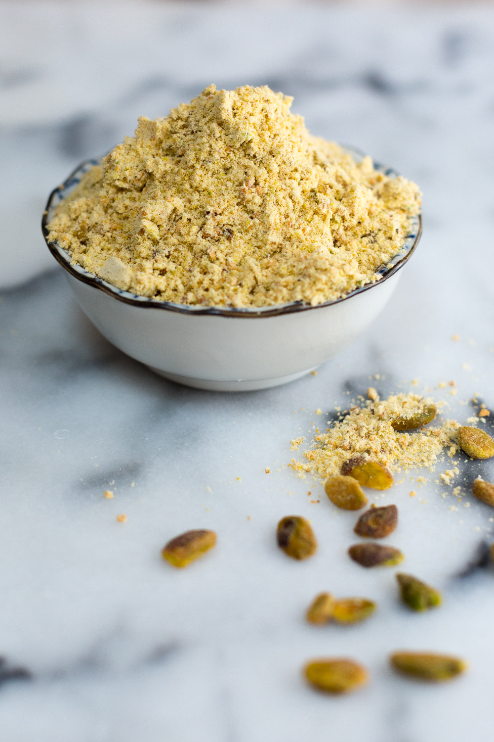 ground pistachios for Ricotta & Amarena Cherry Tart with Pistachio Crust