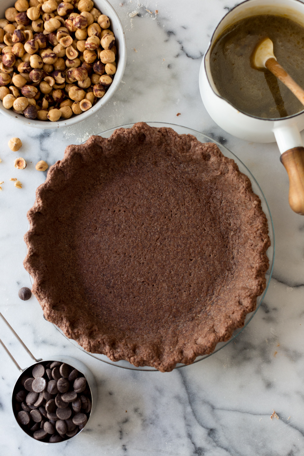 Chocolate Hazelnut Maple Bourbon Pie blind baked shell.