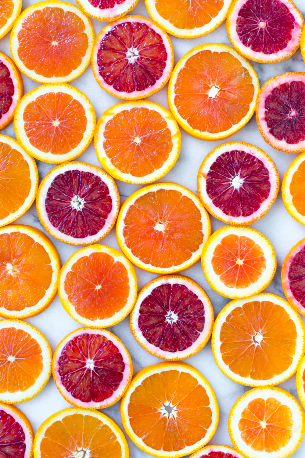Broiled Orange Whipped Ricotta Toasts-Slices of Cara Cara Oranges and Blood Oranges