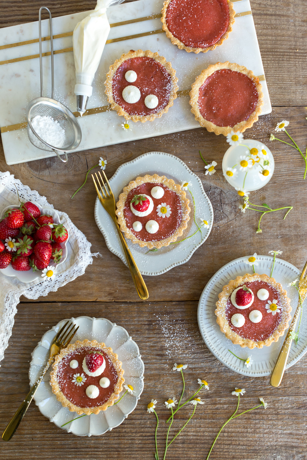 Topping Strawberry Rhubarb Curd Tartlets with creme fraiche