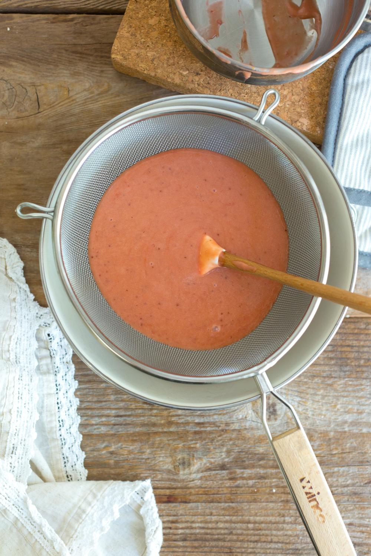 Straining curd for Strawberry Rhubarb Curd Tartlets